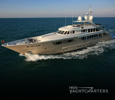 cream-colored motor yacht ALEXANDAR V running