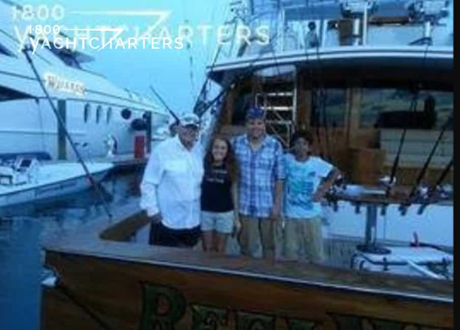Yacht owner RICK HENDRICKS at back of sportfish yacht named Reel Wheels, with his family