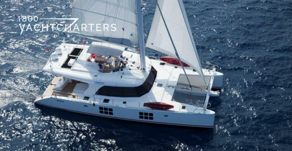 IN THE WIND catamaran sailboat charter aerial view under sail 1800yachtcharters