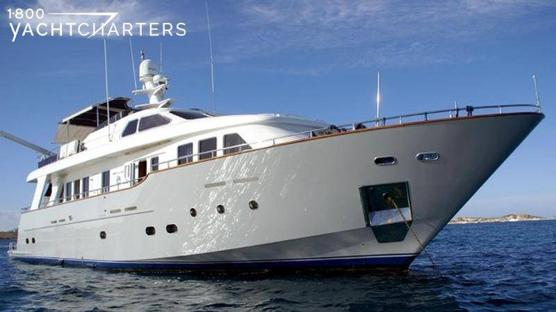 profile of motoryacht with grey hull and white superstructure