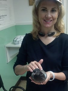 Jana helps injured bird at local veterinary office