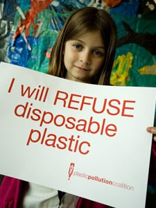 Kid holding up sign refusing disposable plastic by Jan Vozenilek