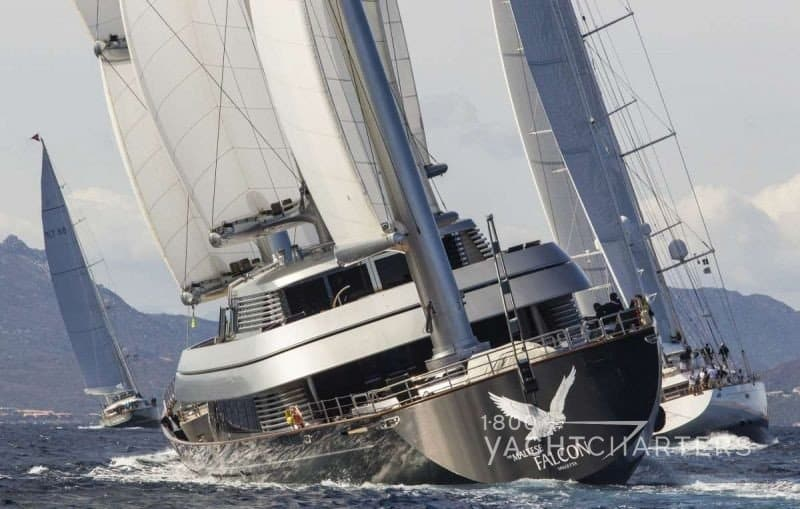 Maltese Falcon Perini Navi sailboat racing seen from back of yacht - sails up - boat leaning left