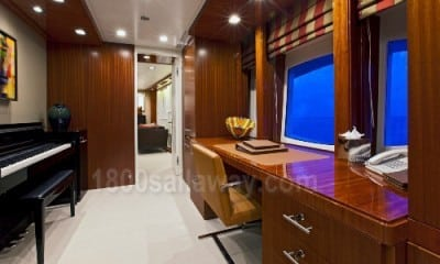 Photograph of owner office on a yacht. It has a piano inside.