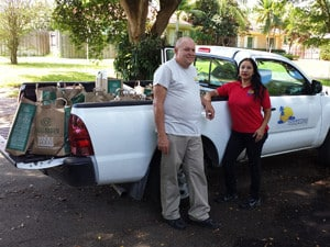 Jana Sheeder & 1-800 Yacht Charter Team Distribute Food