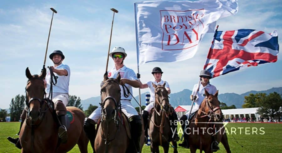 4 Polo players on brown horses with a British Flag and a flag that reads British Polo Day