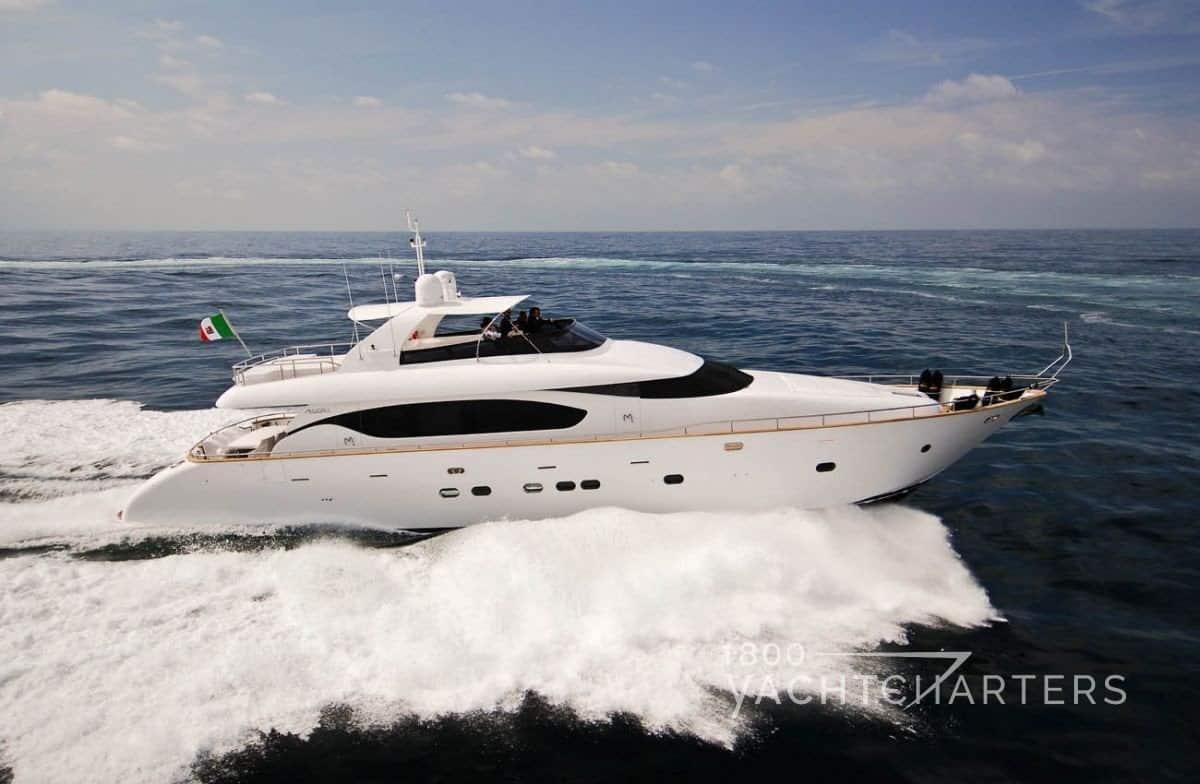 MIREDO Maiora motoryacht running - solid white sleek yacht with waves below