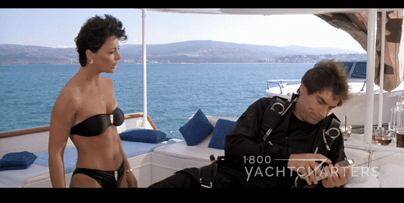 James Bond 007 movie The Living Daylights scene on yacht deck - Timothy Dalton - Belle Avery Kell Tyler in black bikini