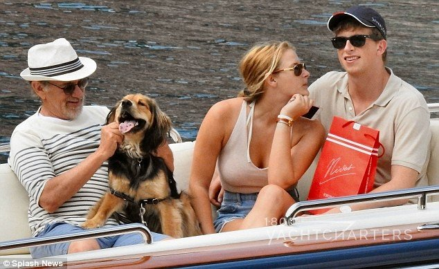 steven spielberg, his dog, and family members onboard dinghy during yacht charter
