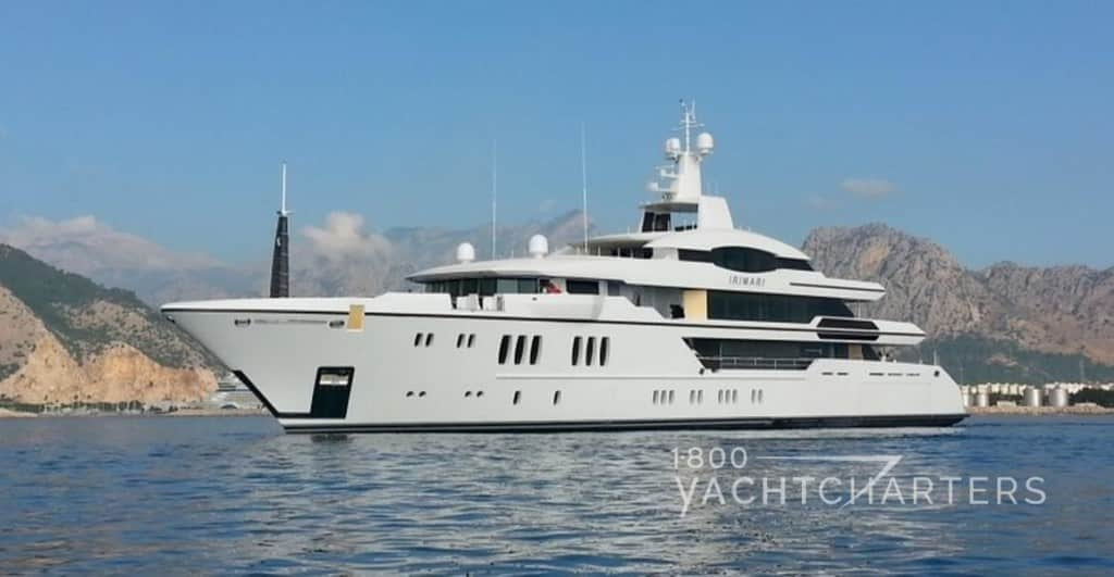 superyacht Irimari side profile solid white boat at anchor on calm sea