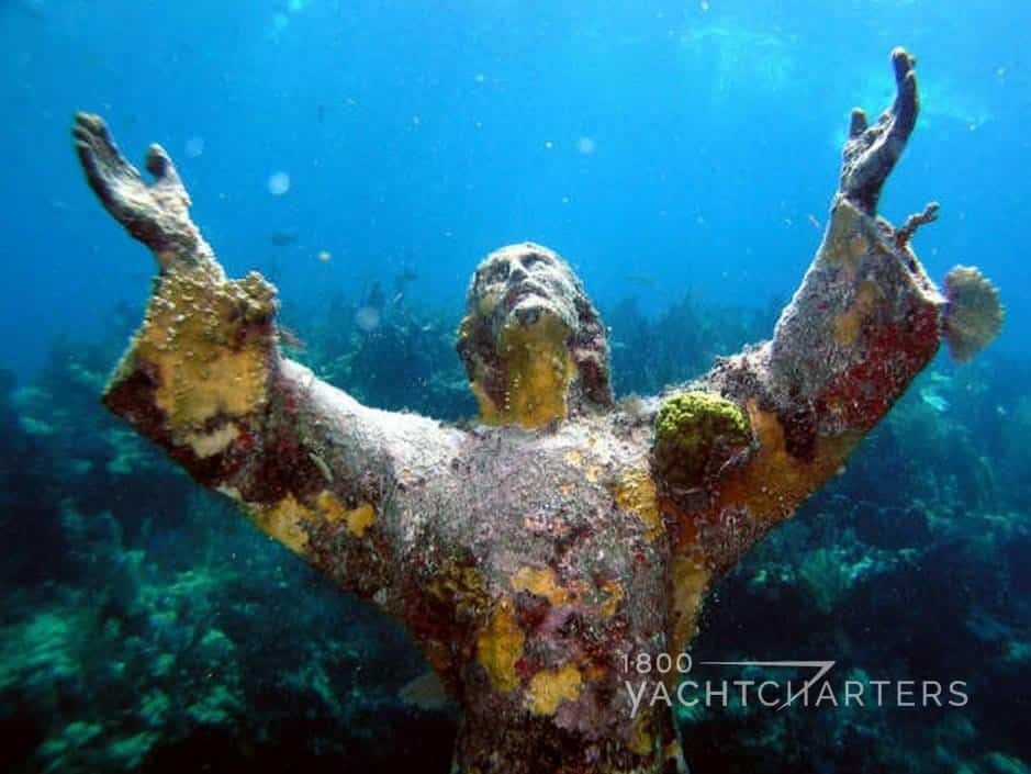 statue of christ at john pennekamp underwater state park in key largo florida - christ looking up with outstretched arms