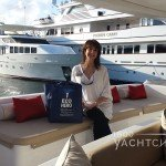 Jana Sheeder sitting on the aft couch of a yacht in a marina
