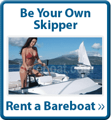 Sign that reads, Be Your Own Skipper at top. Center is photo of a woman sailing a yacht, with another sailboat in the background.  The bottom reads, Rent a bareboat.
