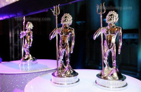 Photograph of multiple Superyacht Award trophies. They are called Neptunes. They look like little men holding a pitchfork, as if Neptune, underwater.