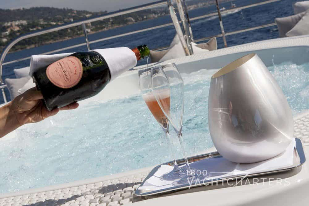 Champagne in hot tub on yacht charter