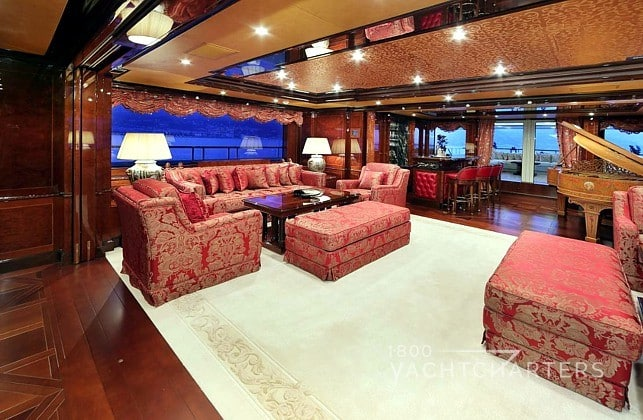 Salon of superyacht Ulysses in red ones with gold highlights