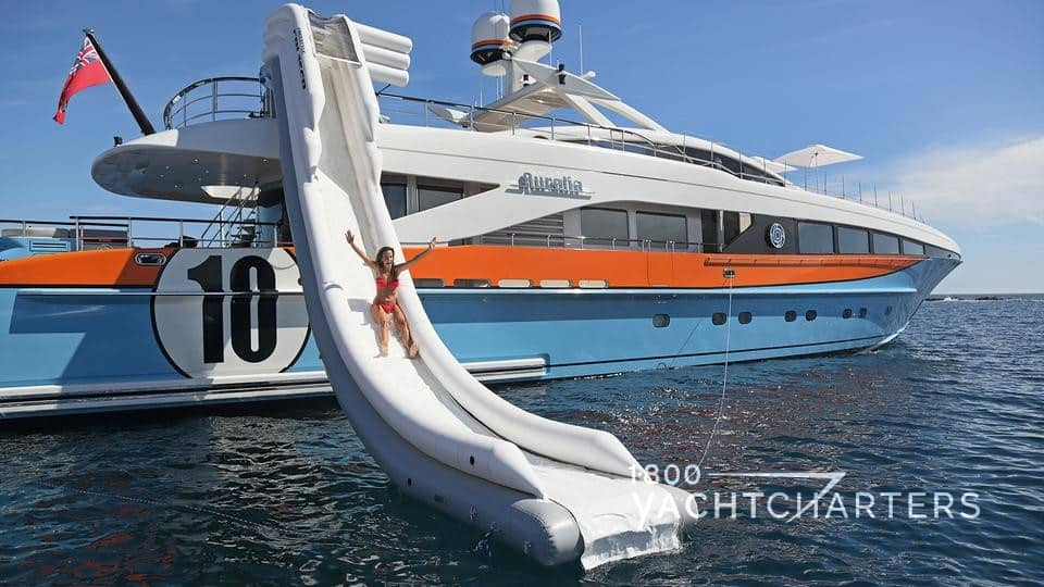 A girl sliding down the inflatable slide from motoryacht Aurelia