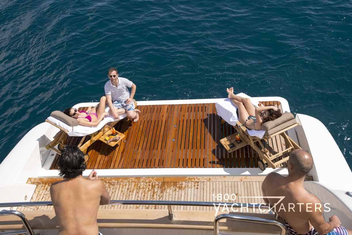 People on the swim platform of superyacht The Wellesley