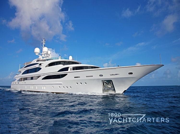 White hulled Benetti yacht charter boat underway