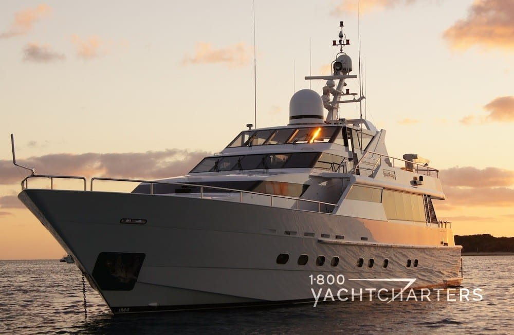 OSCAR II yacht charter australia boat profile in the sunset
