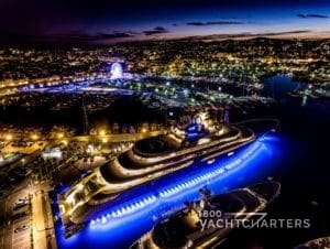 Dilbar large private yacht in Antibes France with underwater lights at night