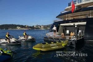 Back of superyacht Ulysses with toys in the water