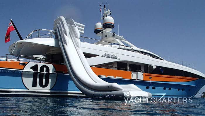Motoryacht Aurelia with inflatable slide deployed into the water