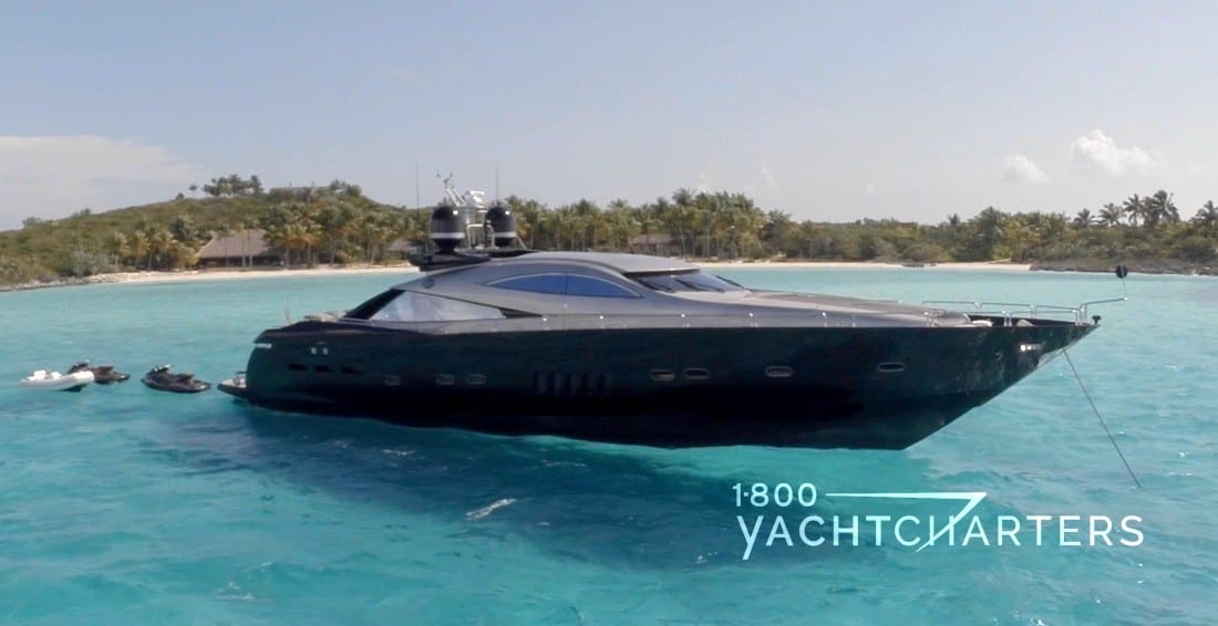 Murcielago yacht anchored in turquoise water with an island in the background