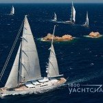 multiple sailboats sailing in a race with a large Perini Navi sailboat in the foreground