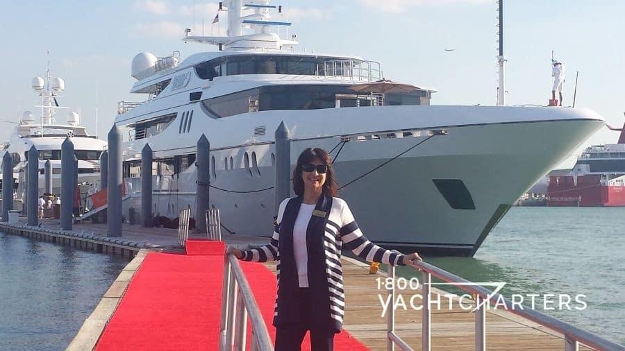 DOUBLE DOWN superyacht behind Jana Sheeder on superyacht docks