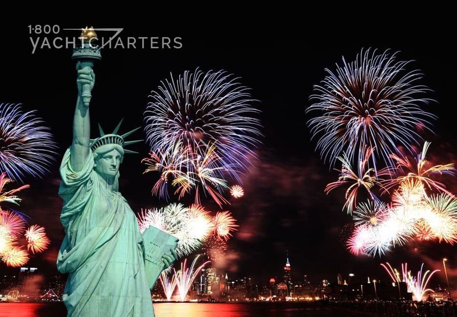Fireworks in the air behind the Statue of Liberty