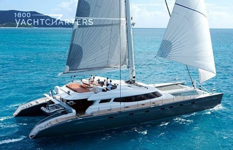 Catamaran allures - black hull and white superstructure with white sails