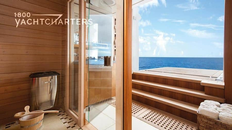 yacht wellness room that looks out on the ocean - wooden floors and glass doors