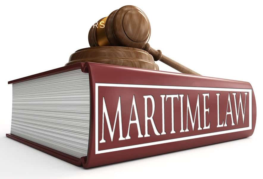 photo of large red Maritime book on its side with a gavel lying on top