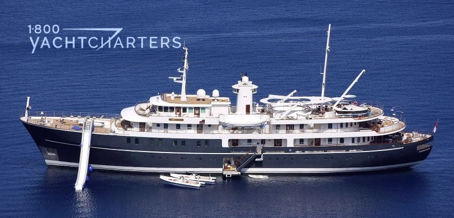 Profile of yacht SHERAKHAN with blue hull and white superstructure