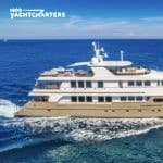 Profile of LOON motoryacht - facing right - yacht has white superstructure and beige body