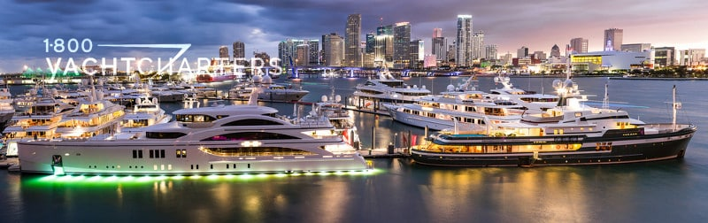 Sunset photo of dock of superyachts at Miami Yacht Show