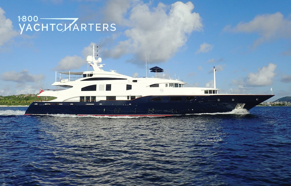 Motoryacht Lady Michelle profile - facing right - yacht has dark blue hull and white superstructure