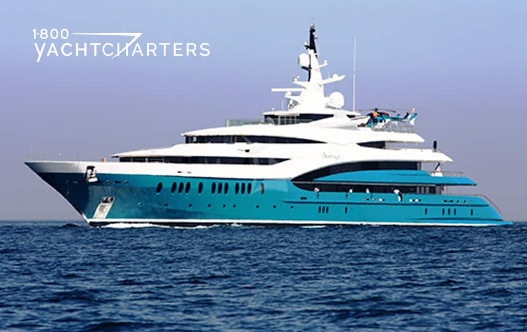 Sunrays motoryacht underway, heading left. Hull is teal turquoise, and superstructure is white