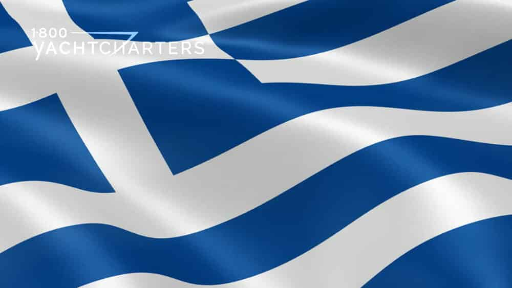 Close up view of blue and white Greek flag. It is a wavy design, as if the flag is waving.  The flag has royal blue and white horizontal stripes and a white cross in the top left corner,incorporated within the blue and white stripes.