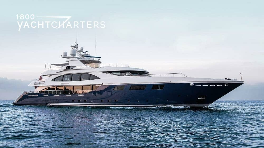 Profile of superyacht ARBEMA. She has a blue hull and white superstructure. The yacht is facing the center of the right side of the image.