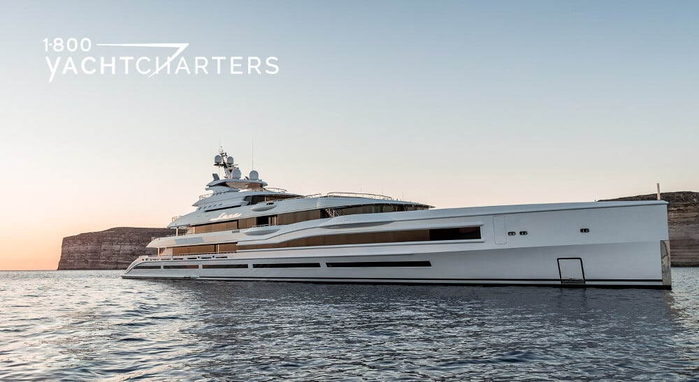 Side profile photograph of a solid white superyacht named Lana. She is facing the right side of the picture.